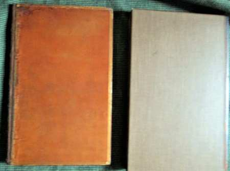 The brown leather book and the slipcase for the book.
