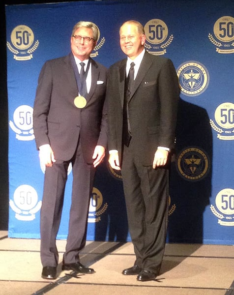 Don Moen accepts Lifetime Global Achievement Award from ORU President William M. Wilson. Photo courtesy Nelon PR