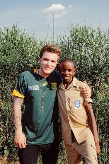 Devine with his sponsor child Evaride