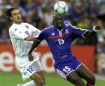 French Lilian Thuram slips away from Italian player Stefano Fiore during the France vs Italy Final of the Euro 2000 soccer championhips in Rotterdam. EFE-EPA/Michele Limina