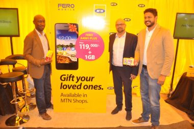 MTN Uganda officials, Keith Tukei General Manager Sales & Distribution (left) and Olivier Prentout, Chief Marketing Officer (center), join Vikram Gopal, Fero representative in Uganda (right) for a photo pose during the launch of the Fero A4100