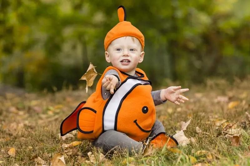 Halloween toddler in pumpkin suit