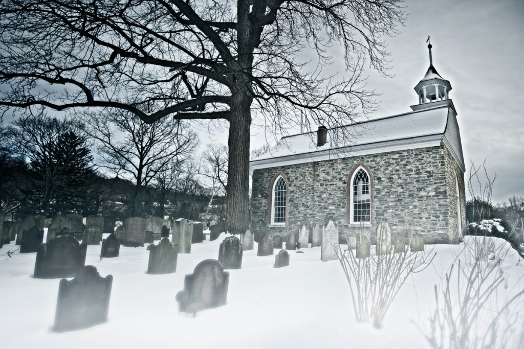 The Old Dutch Church and burial ground of Sleepy Hollow, legendary in American folk horror from Haunted Travels in the Hudson River Valley of Washington Irving