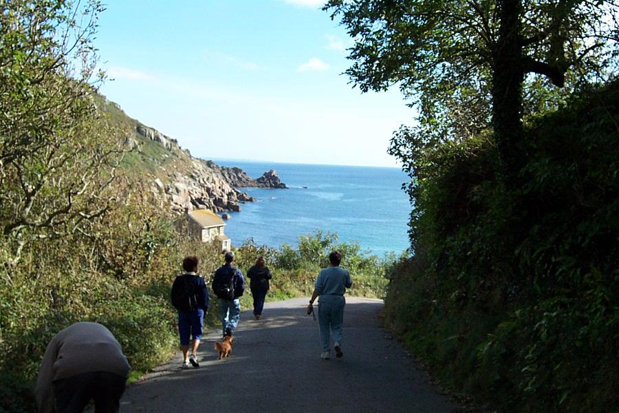 Walking down to Lamorna Cove Cornwall