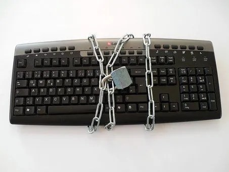 an image of a locked keyboard depicting the employee off-boarding process