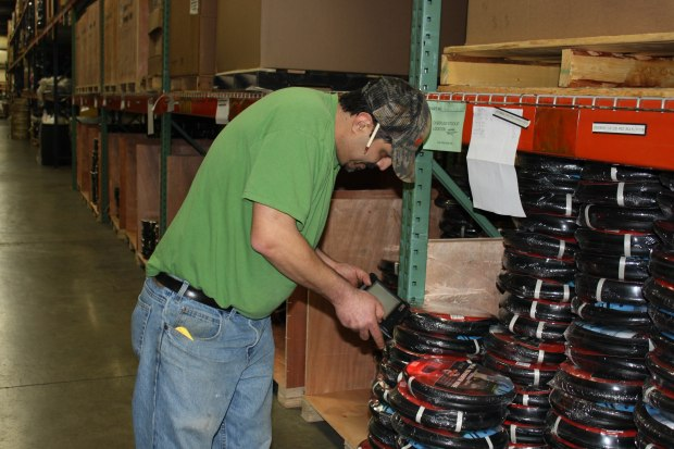 Warehouse workers use rugged tablets on and off forklifts for inventory management and pick and run applications.