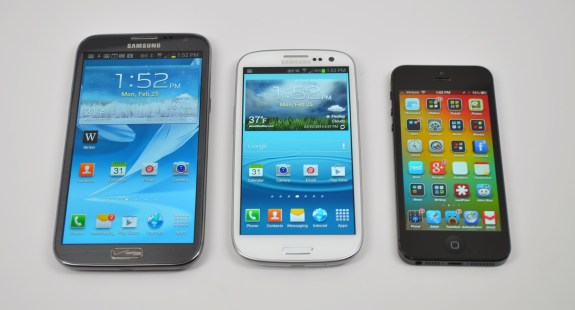 The iPhone 5 next to the Galaxy S3 and Galaxy Note 2.