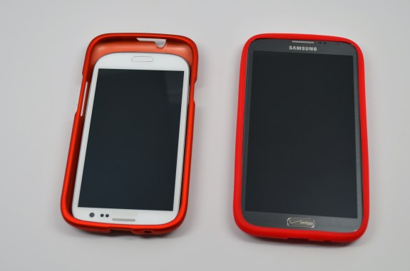 The Samsung Galaxy S3 and Galaxy Note 2 inside Galaxy S4 cases.
