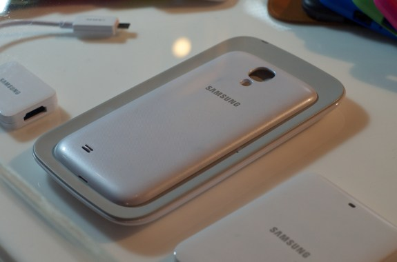 The Galaxy S4 features wireless charging. but it's not built-in.