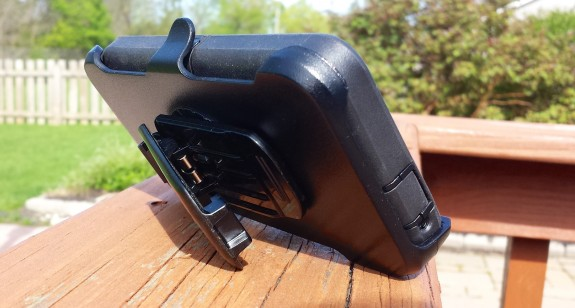 The HTC One case belt clip acts as a stand.