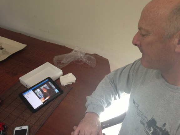 My father on his birthday watching a video of his dad