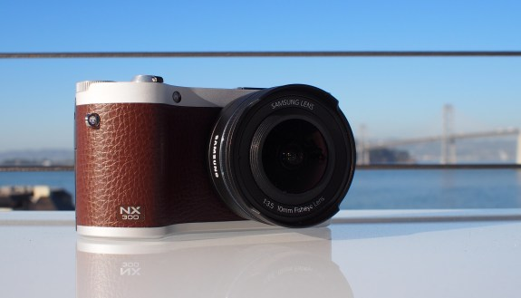 The 10mm lens attached to a Samsung NX300 camera in brown.