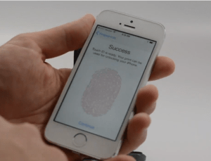 Train Touch ID on the iPhone 5s.