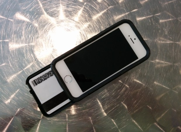 Store several cards and cash in the OtterBox iPhone 5 wallet case.
