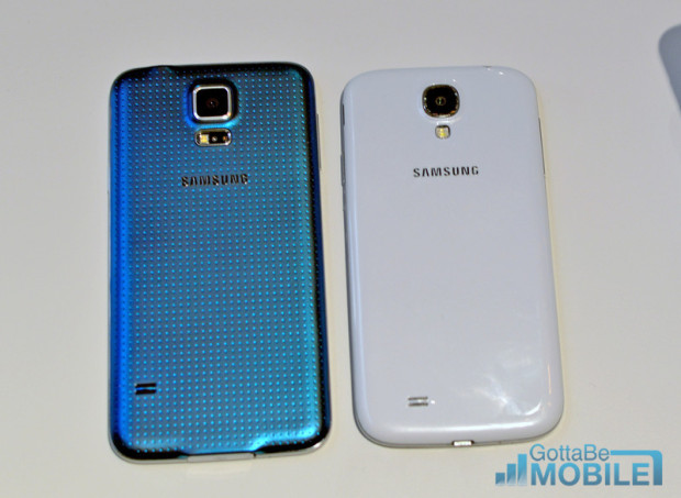 The Galaxy S5 on the left features a new plastic design, compared to the smooth plastic on the S4.