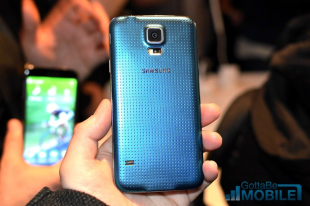 The Galaxy S5 design includes a removable back with a new dimpled design.