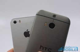 The new HTC One features two rear facing cameras, to the iPhone 5s' one.