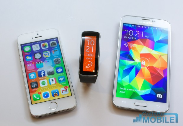 The Galaxy S5 can connect to a Gear Fit, but there is no iWatch yet.