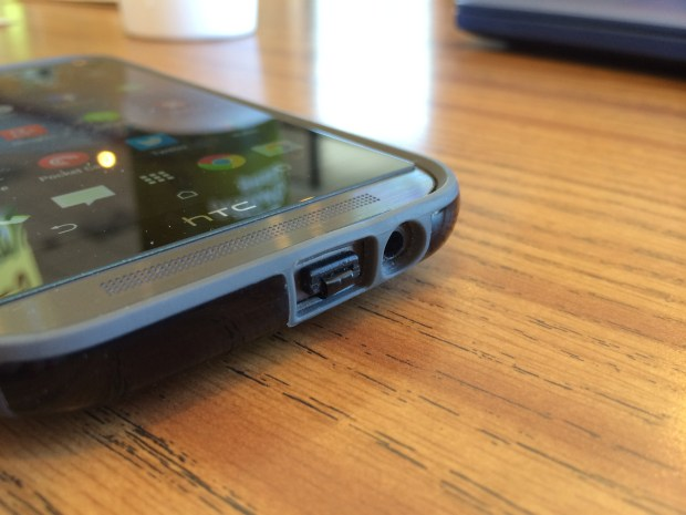 qi-enabled charging film plugged into htc one micro-usb port