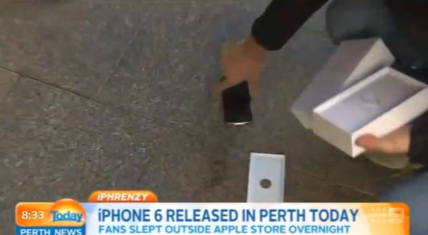 Watch as the first iPhone 6 buyer drops his new iPhone on the sidewalk.