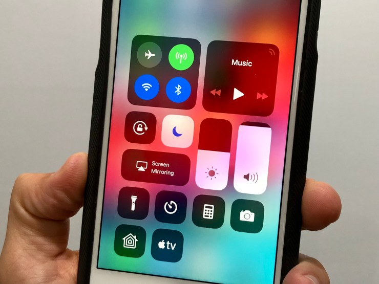 Open Control Center and tap the moon to turn off Do Not Disturb so that your phone will ring.