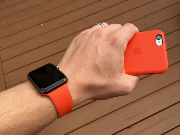 The official Apple iPhone 6s silicone case matches the Apple Watch band in orange.