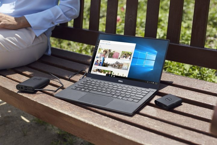 A Dell XPS 13 on a park bench.