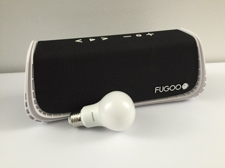 The Fugoo XL next to a standard household light bulb.