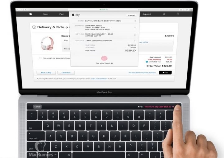 This is the 2016 MacBook Pro with Touch ID and an OLED display above the keyboard.