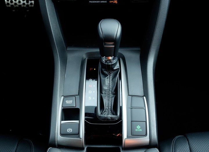 There is no manual option on the Sport Touring trim level.