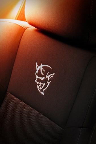 Front seat(s) in 2018 Dodge Challenger SRT Demon feature standard performance cloth with Ballistic II inserts marked by an embroidered Demon logo.