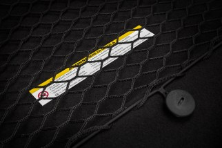 The standard rear cabin area of the 2018 Dodge Challenger SRT Demon has a rear seat delete cargo net for storage.