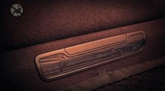 The 2018 Dodge Challenger SRT Demon's rear-seat-delete access cover depicts a drag strip with SRT Demon burnout.