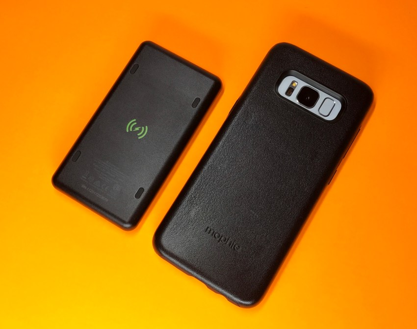 The leather case includes magnets to attach a wireless charging battery.