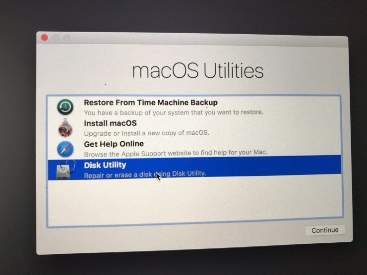 Run disk utility to fix a Mac that won't boot after installing macOS High Sierra.