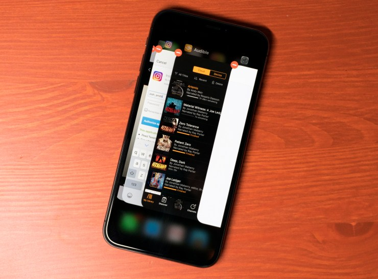 Force close running apps on the iPhone X.