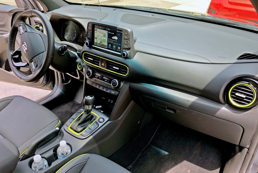 A roomy front seat area with easily reachable controls and optional lime accents.