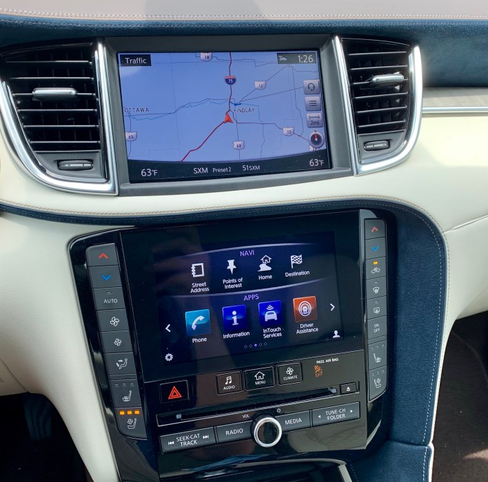You get two screens, but neither supports Apple CarPlay or Android Auto.