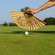 Image of fan cooling off hot weather golf