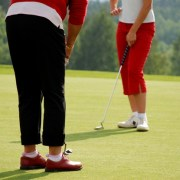 Image of two women putting
