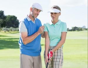 Man giving woman golf advice