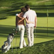 Image of couple on golf course