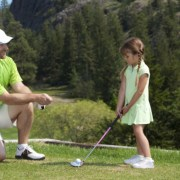 Image of dad coaching daughter