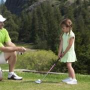 Image of dad coaching daughter