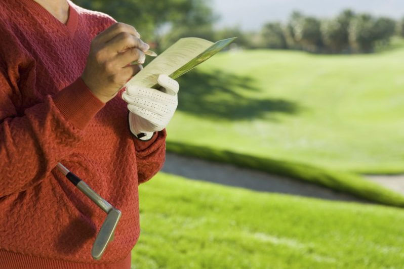 Image of woman adjusting golf course length