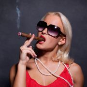 Image of woman smoking cigar