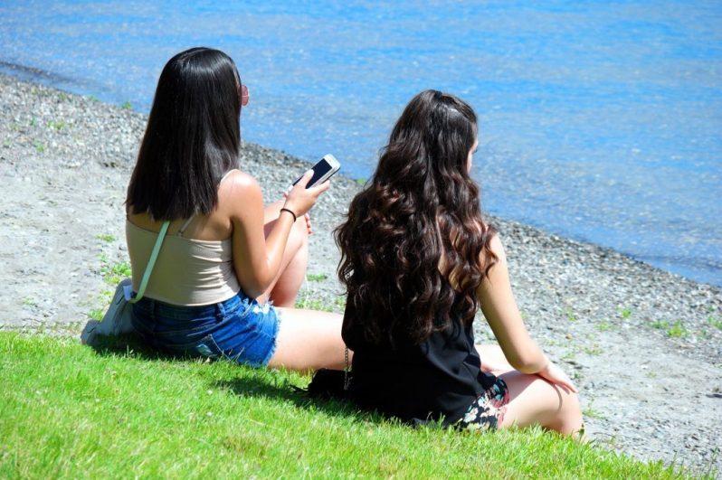 Image of millennials on phones