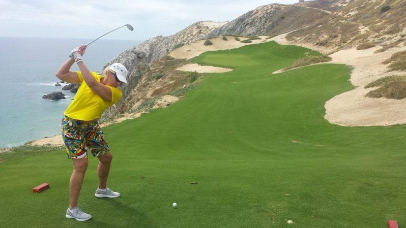 Image of woman teeing off at Quivira's sixth hole