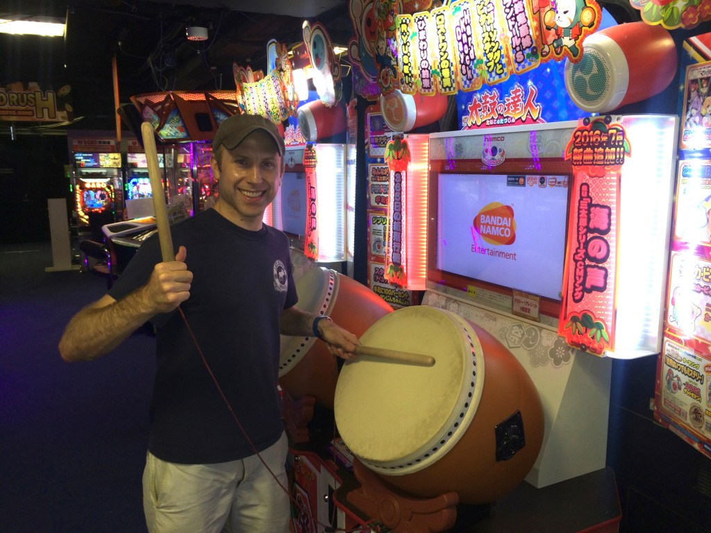 Playing the drumming game at the arcade