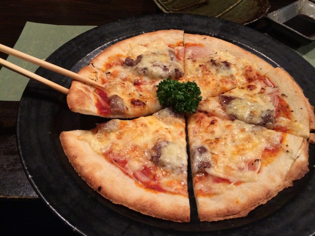 Tearing into the Hida beef pizza!